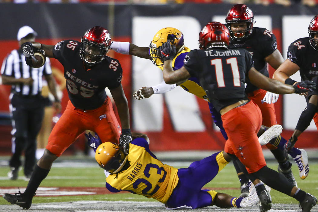 UNLV Rebels running back Xzaviar Campbell (35) tries to run the ball past Prairie View A&M Panthers cornerback Jaylen Harris (23) during the first half of a football game at Sam Boyd Stadium i ...
