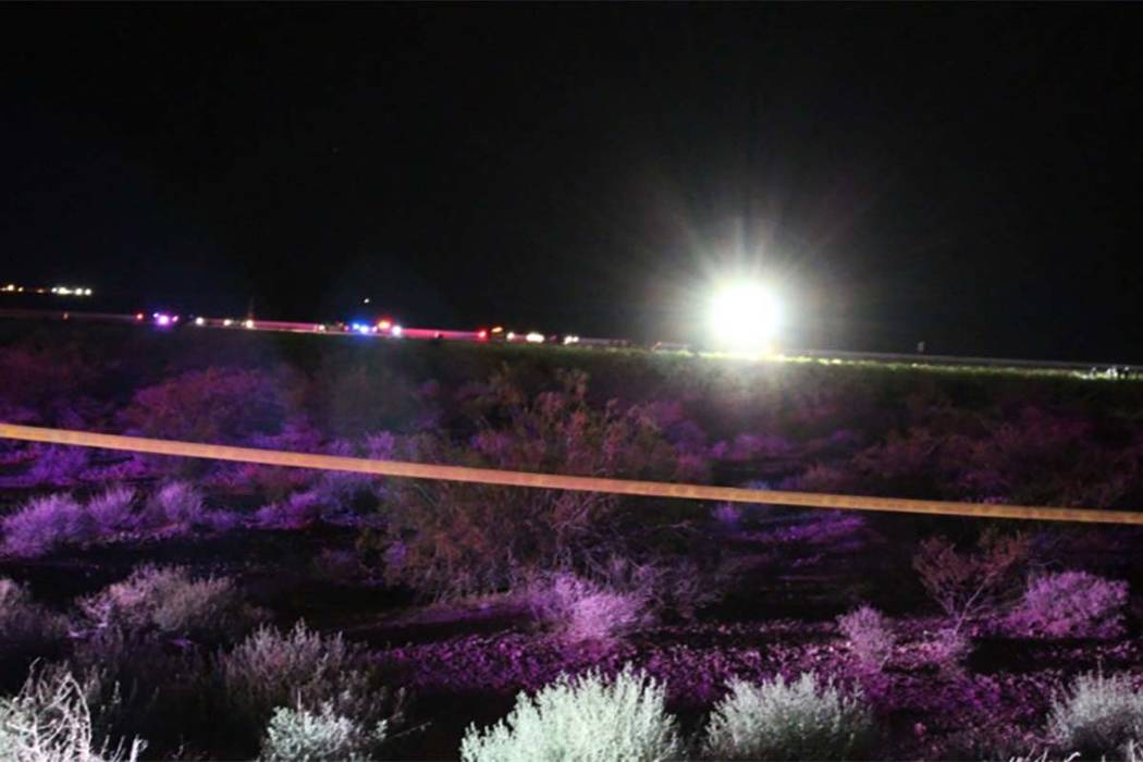 Investigators remain on scene after a single-engine plane crashed in a desert area just north of Jean. This is the view from Las Vegas Boulevard South looking toward the I-15. (Max Michor/Las Vega ...