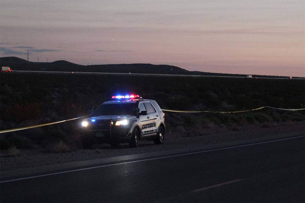 Metropolitan Police Department officers block off a stretch of desert between Interstate 15 and Las Vegas Boulevard South after a small plane crashed just north of Jean Wednesday night. (Max MIch ...