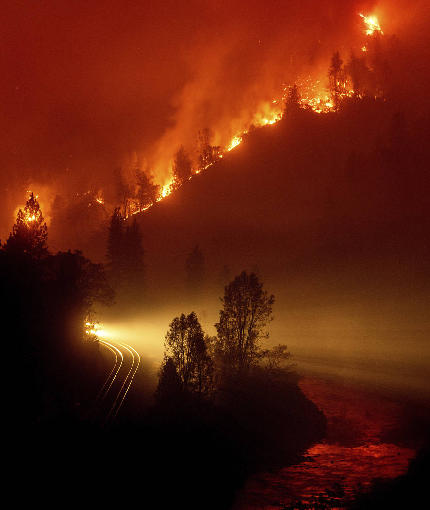 The Delta Fire burns in the Shasta-Trinity National Forest, Calif., on Thursday, Sept. 6, 2018. The wildfire closed both directions of Interstate 5 leaving trucks parked on the shoulder for more t ...