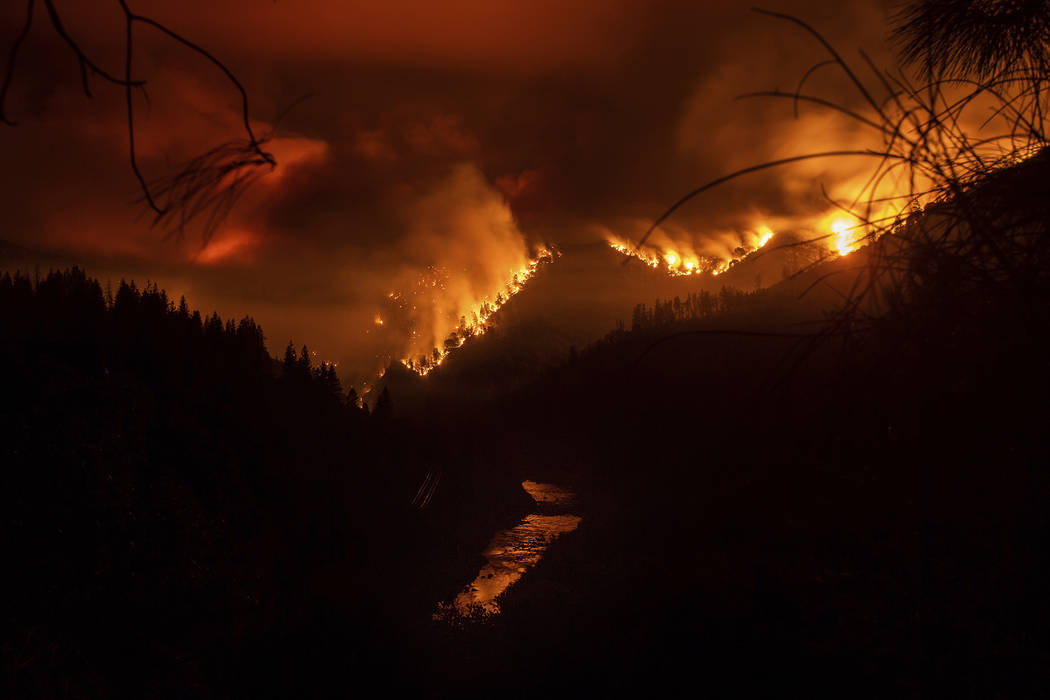 The Delta Fire burns in the Shasta-Trinity National Forest, Calif., on Wednesday, Sept. 5, 2018. Parked trucks lined more than two miles of Interstate 5 as both directions remained closed to traff ...