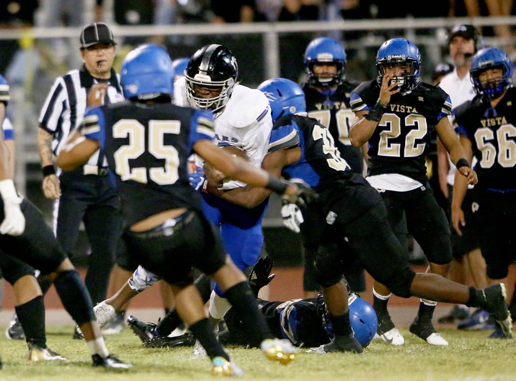 Desert Pine High School's Darnell Washington (13) tackles Sierra Vista's Mekhi Mercer (25) during a game against Sierra Vista in Las Vegas, Friday, Sept. 14, 2018. Rachel Aston Las Vegas Review-J ...
