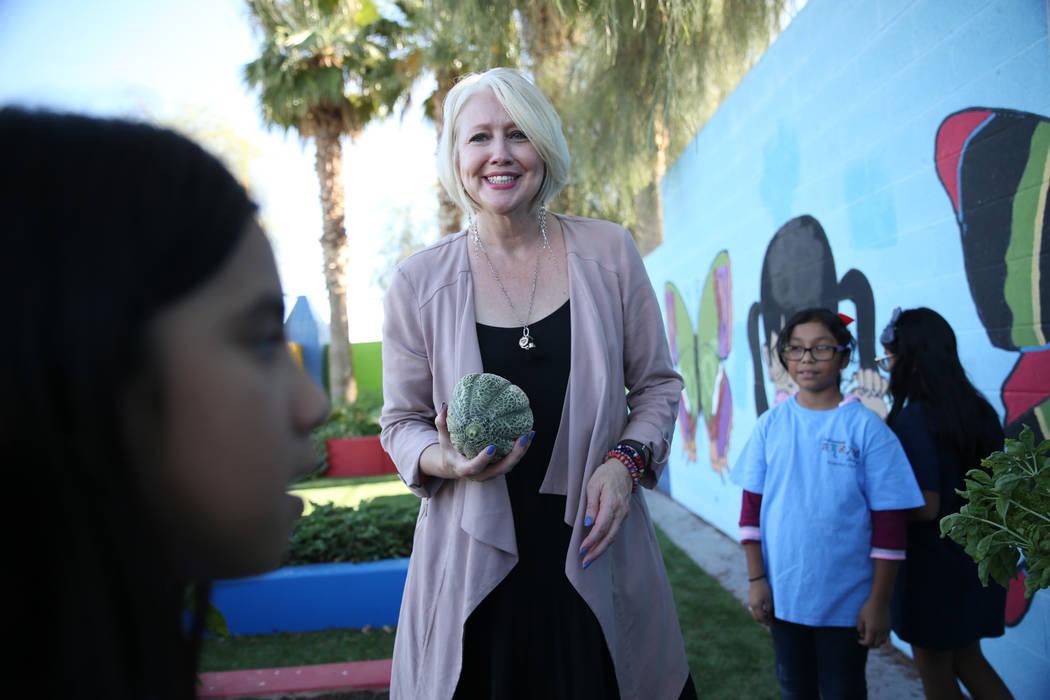 Gina Gavan, center, founder of Project Dinner Table, speaks with children visiting the garden at Hollingsworth Elementary School in Las Vegas, Friday, Sept. 7, 2018. Erik Verduzco Las Vegas Review ...