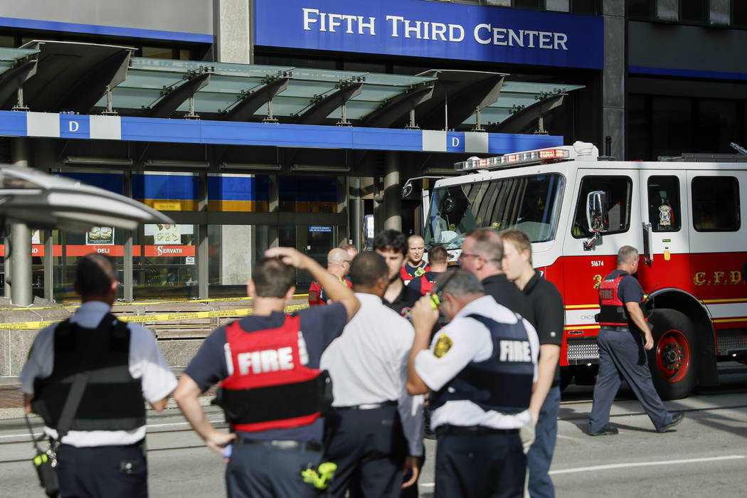 Emergency personnel and police respond to reports of an active shooter situation near Fountain Square, Thursday, Sept. 6, 2018, in downtown Cincinnati. (John Minchillo/AP)