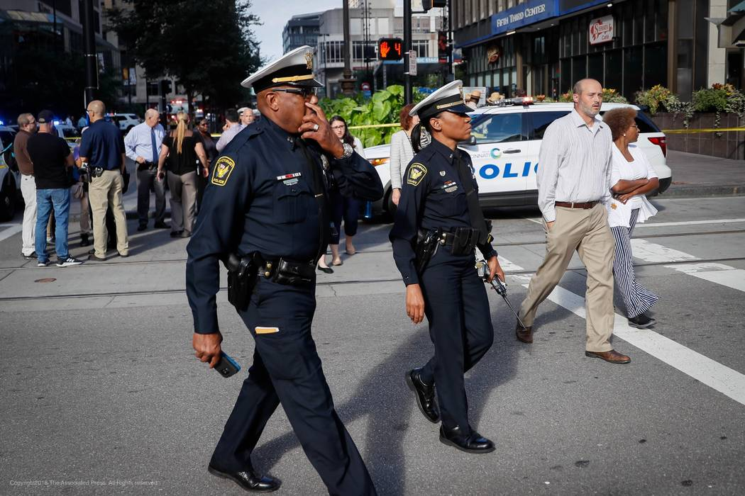 Emergency personnel and police respond to a reported active shooter situation near Fountain Square, Thursday, Sept. 6, 2018, in downtown Cincinnati. (John Minchillo/AP)