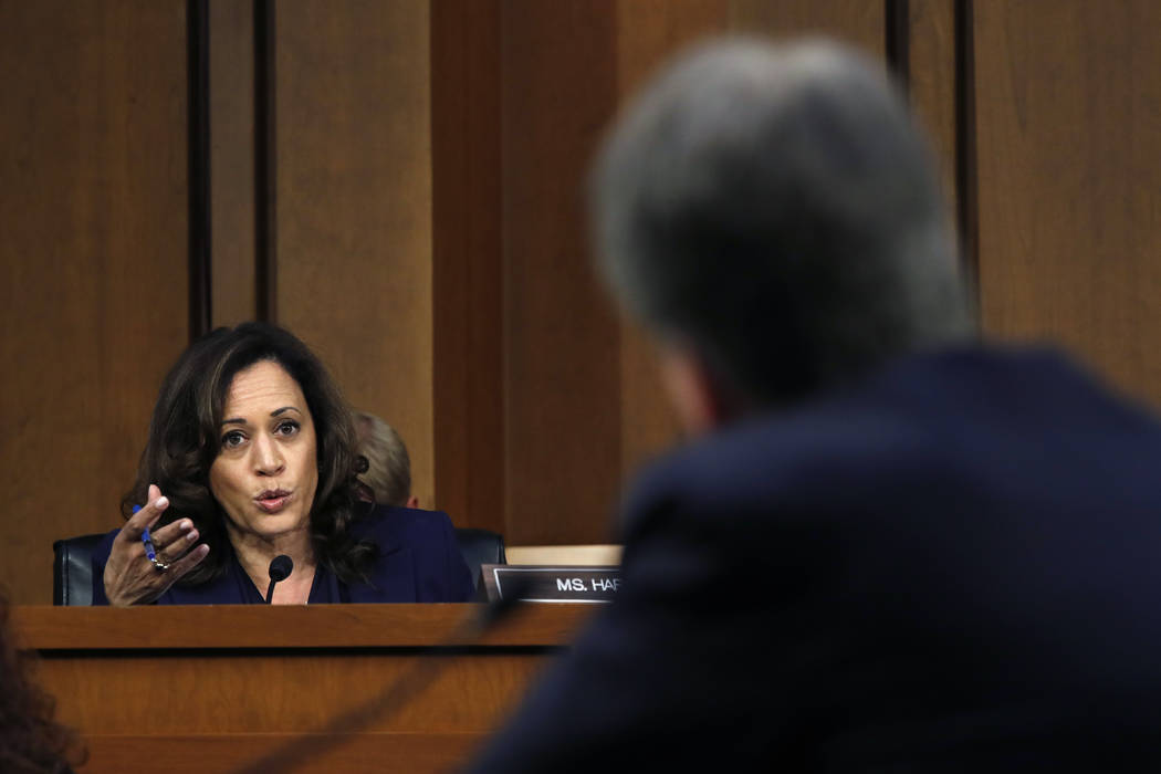 Sen. Kamala Harris, D-Calif., left, questions President Donald Trump's Supreme Court nominee, Brett Kavanaugh, in the evening of the second day of his Senate Judiciary Committee confirmation heari ...