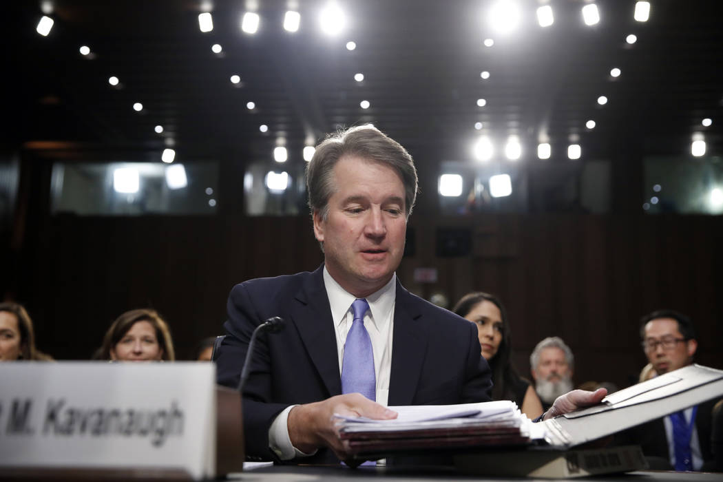 President Donald Trump's Supreme Court nominee, Brett Kavanaugh readies his papers before he testifies before the Senate Judiciary Committee on Capitol Hill in Washington, Thursday, Sept. 6, 2018, ...