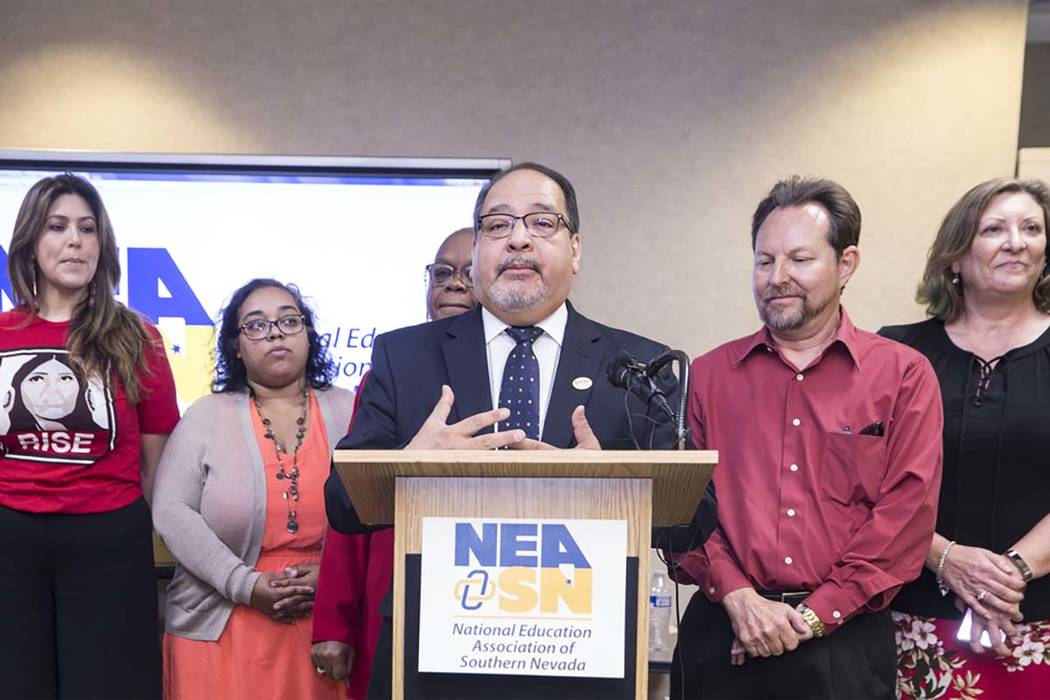 Ruben Murillo, middle, president of the Nevada State Education Association, announces a new teachers union for Clark County educators called the National Education Association-Southern Nevada on T ...