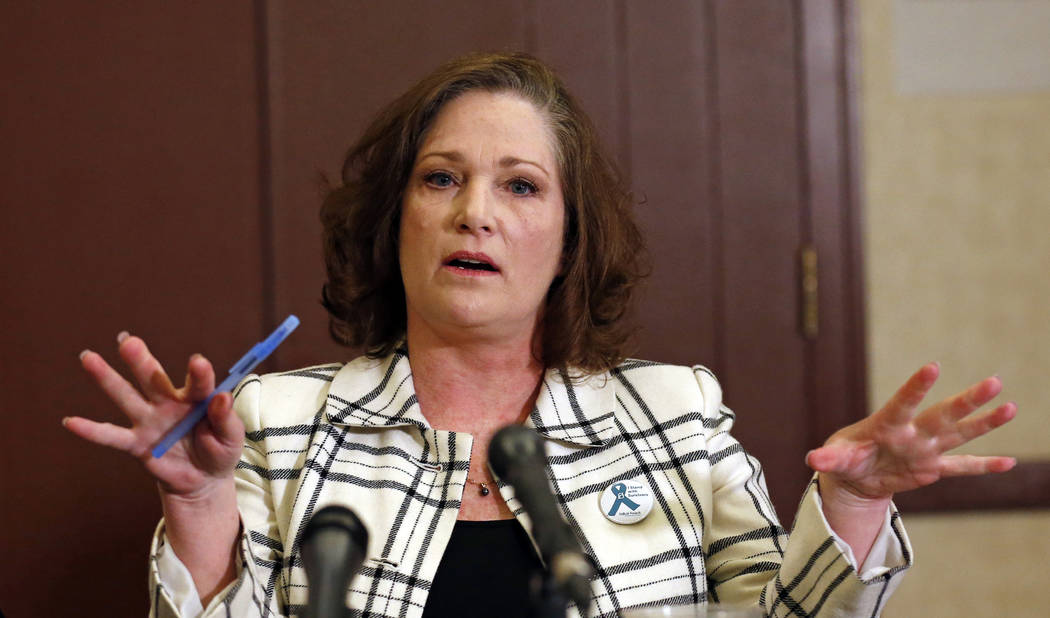 McKenna Denson speaks with reporters during a news conference in Salt Lake City on April 5, 2018. (AP Photo/Rick Bowmer, File)