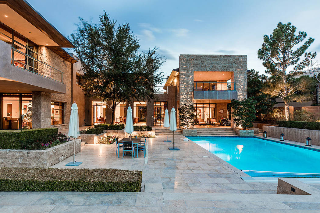 Elements of midcentury modern are integrated into the overall design, including a centralized exterior courtyard surrounded by the main living areas. (Ivan Sher Group)