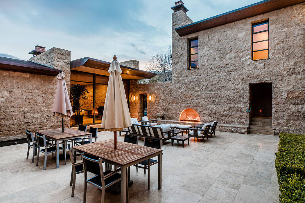 The courtyard has a fireplace. (Ivan Sher Group)