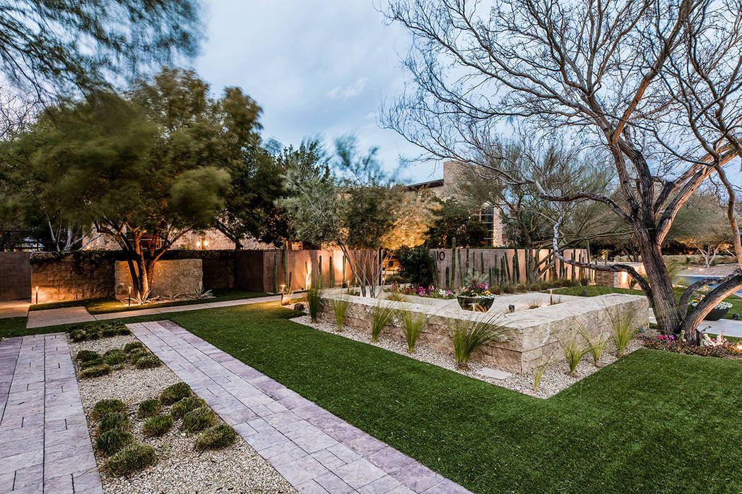 The Ridges home has a mix of lush and desert landscaping. (Ivan Sher Group)