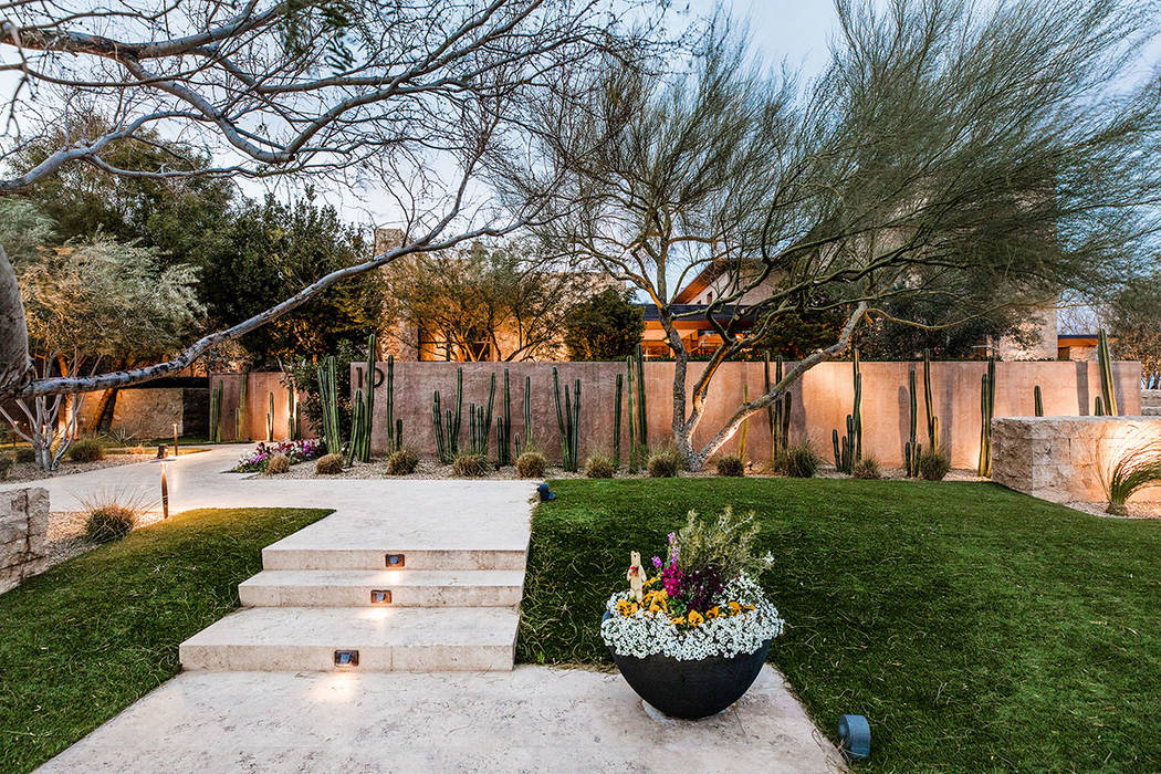 The desert landscaping is full and colorful. (Ivan Sher Group)