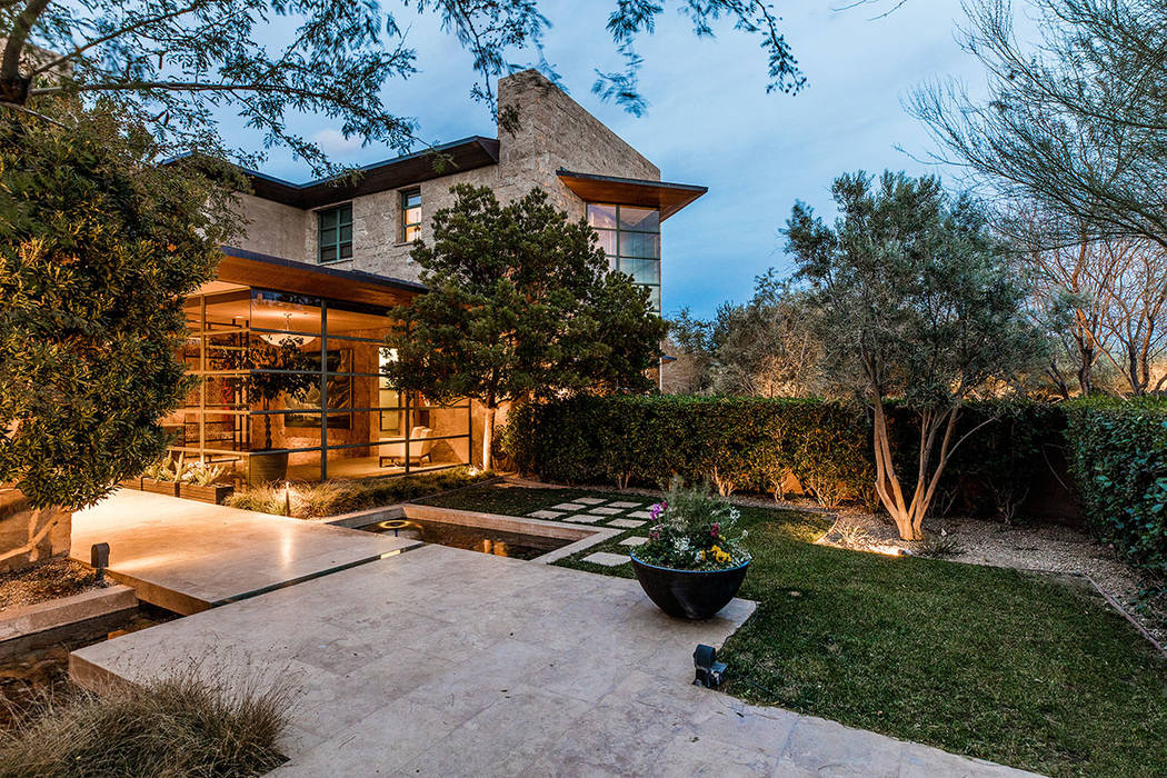 The home has a lot of floor-to-ceiling windows that showcase the backyard and courtyard. (Ivan Sher Group)