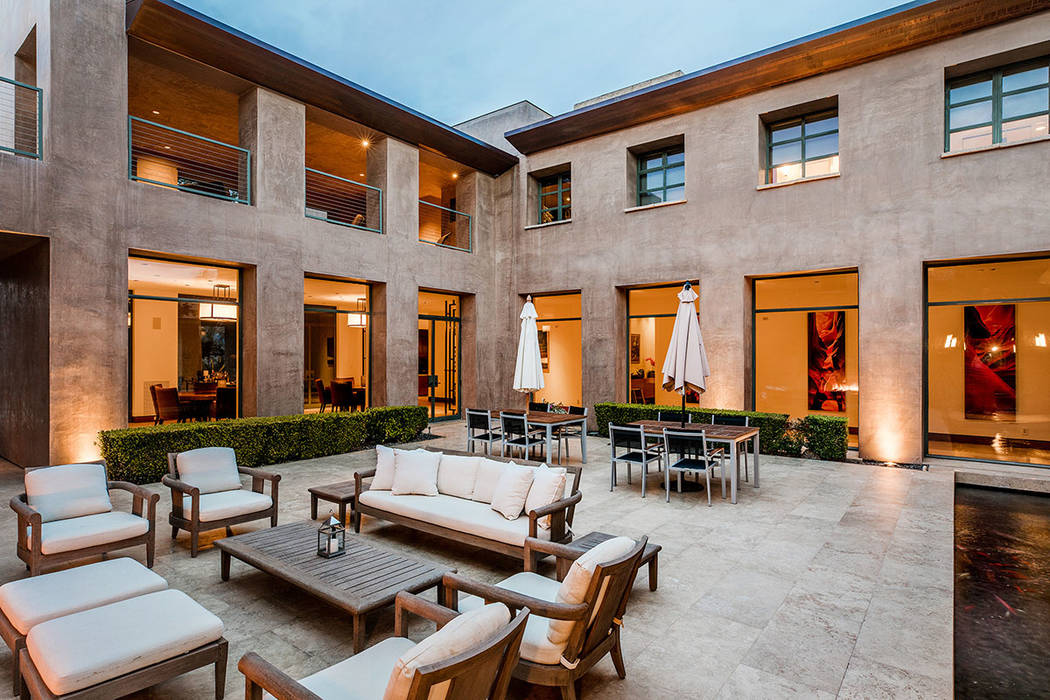 The central courtyard connects the different areas of the home. (Ivan Sher Group)