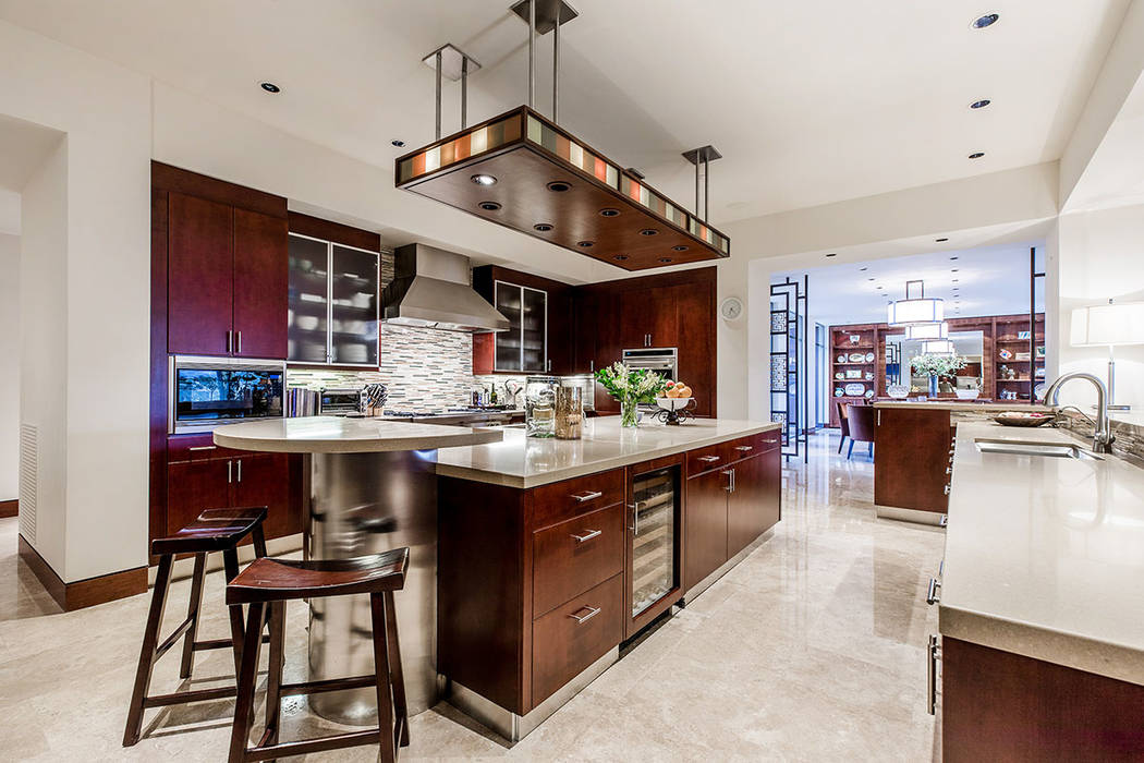 The spacious chef's kitchen provides a well-designed space attired in professional grade appliances, SieMatic custom cabinetry and granite counters. (Ivan Sher Group)