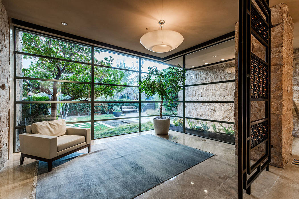 A living room features floor-to-wall windows. (Ivan Sher Group)