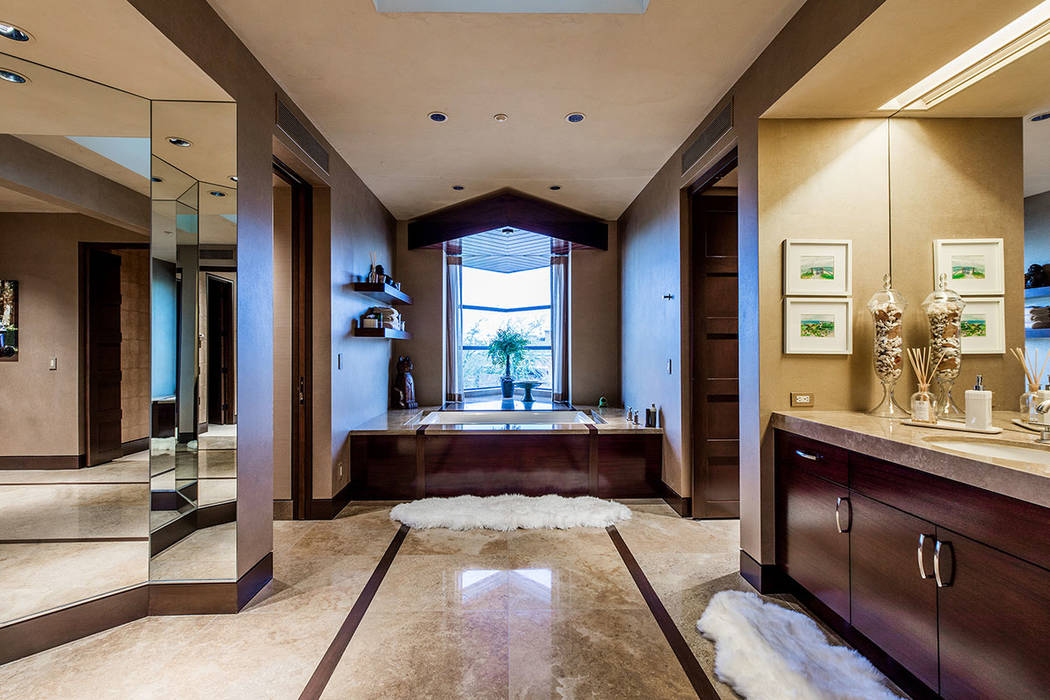 The master bath separates into two private dressing areas. (Ivan Sher Group)