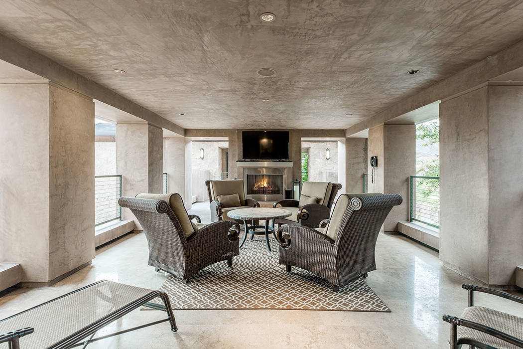 The master suite has an outdoor balcony with a fire feature. (Ivan Sher Group)