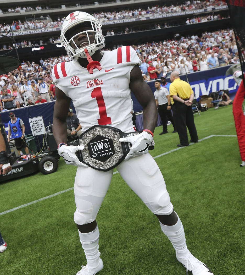 "In this Sept. 1, 2018, photo provided by the Mississippi Athletics Department, Mississippi wide receiver A. J. Brown displays the team's ""Nasty Wide Outs"" belt during an NCAA college football game ..."