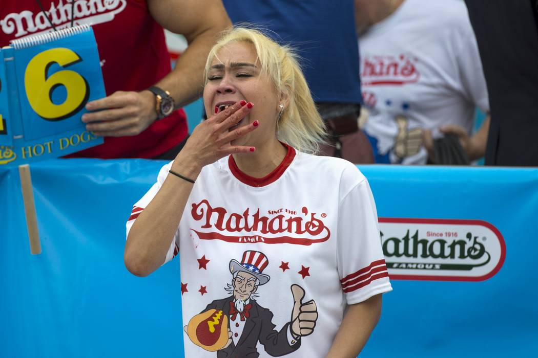 Miki Sudo, winner of Nathan's Famous Hot Dog Eating Contest in the Women's division, eats a hot dog during the competition in Brooklyn, New York July 4, 2015. Sudo finished with a total of 38 hot ...