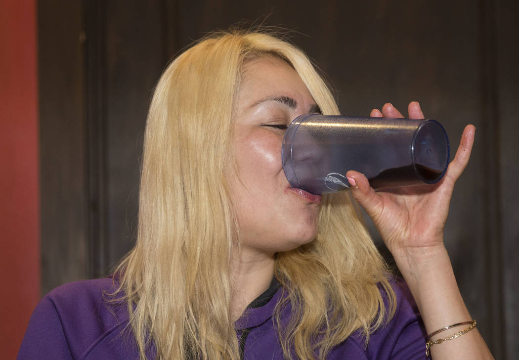 Las Vegas local and competitive eating champion Miki Sudo takes a drink of Diet Pepsi after completing the Double Down Pizza Challenge at Slice of Vegas on Thursday, Sept. 6, 2018, at Mandalay Bay ...