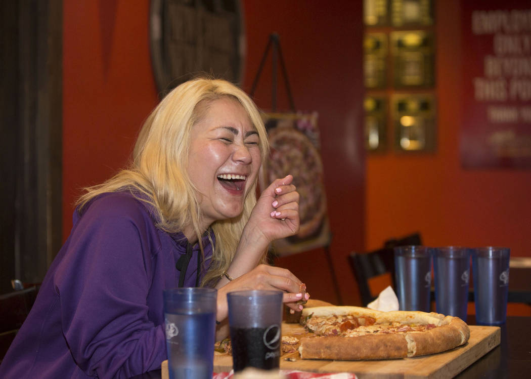 Las Vegas local and competitive eating champion Miki Sudo shares a laugh with friends during her attempt to complete the Double Down Pizza Challenge at Slice of Vegas on Thursday, Sept. 6, 2018, a ...