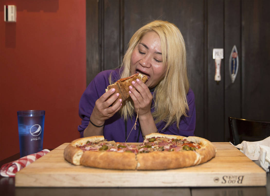 Las Vegas local and competitive eating champion Miki Sudo attempts to complete the Double Down Pizza Challenge at Slice of Vegas on Thursday, Sept. 6, 2018, at Mandalay Bay, in Las Vegas. Benjamin ...