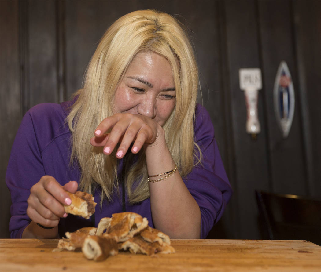 Las Vegas local and competitive eating champion Miki Sudo tries not to laugh while attempting to complete the Double Down Pizza Challenge at Slice of Vegas on Thursday, Sept. 6, 2018, at Mandalay ...