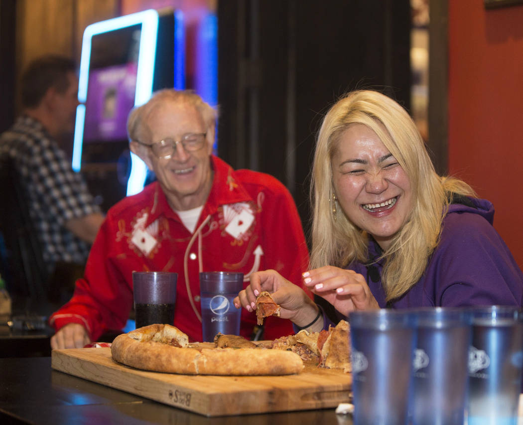 """Las Vegas local and competitive eating champion Miki Sudo, right, shares a laugh with friend and fellow competitive eater Rich """"The Locust"""" LeFevre during her attempt to complete the Dou ..."""