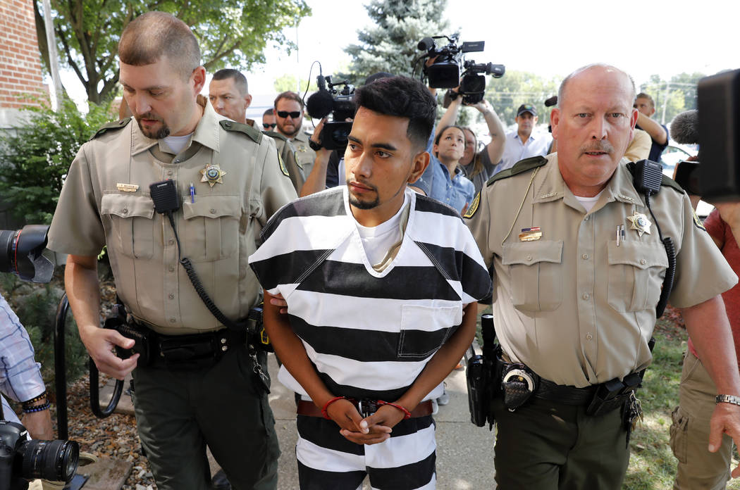 Cristhian Bahena Rivera is escorted into the Poweshiek County Courthouse for his initial court appearance in Montezuma, Iowa on Aug. 22, 2018. (AP Photo/Charlie Neibergall, File)