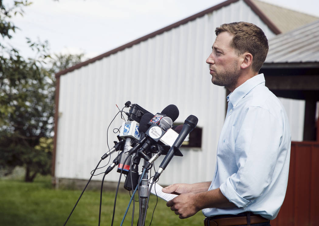 Dane Lang, co-owner of Yarrabee Farms, speaks to the media on the family farm in Brooklyn, Iowa on Aug. 22, 2018. (Brian Powers /The Des Moines Register via AP, File)
