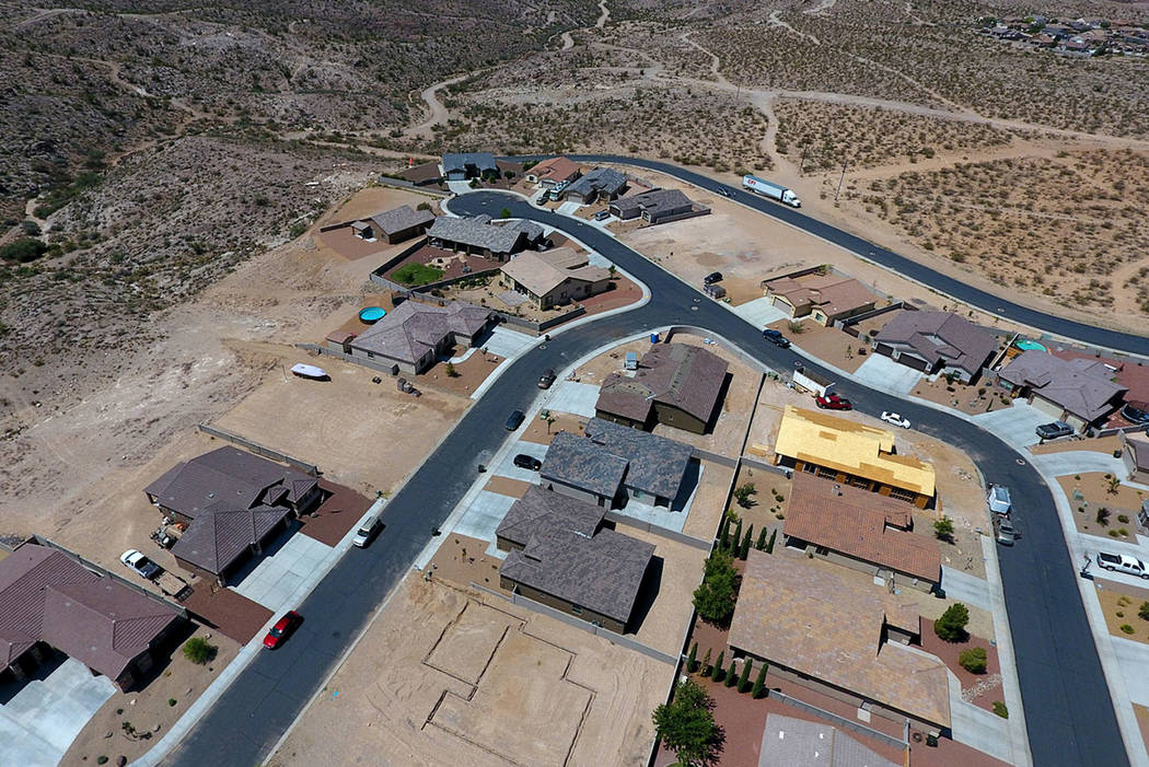 Aerial view of several new homes in different stages of construction in a subdivision off Slaughter House Canyon Road in Kingman, Ariz. on Friday, August 17, 2018. )Michael Quine Las Vegas Review- ...