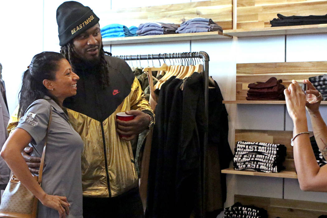 Oakland Raiders running back Marshawn Lynch, right, takes a picture with Sherri Lewis during the grand opening of his store, Beastmode, at Town Square Las Vegas, Saturday, Sept. 1, 2018. Heidi Fan ...