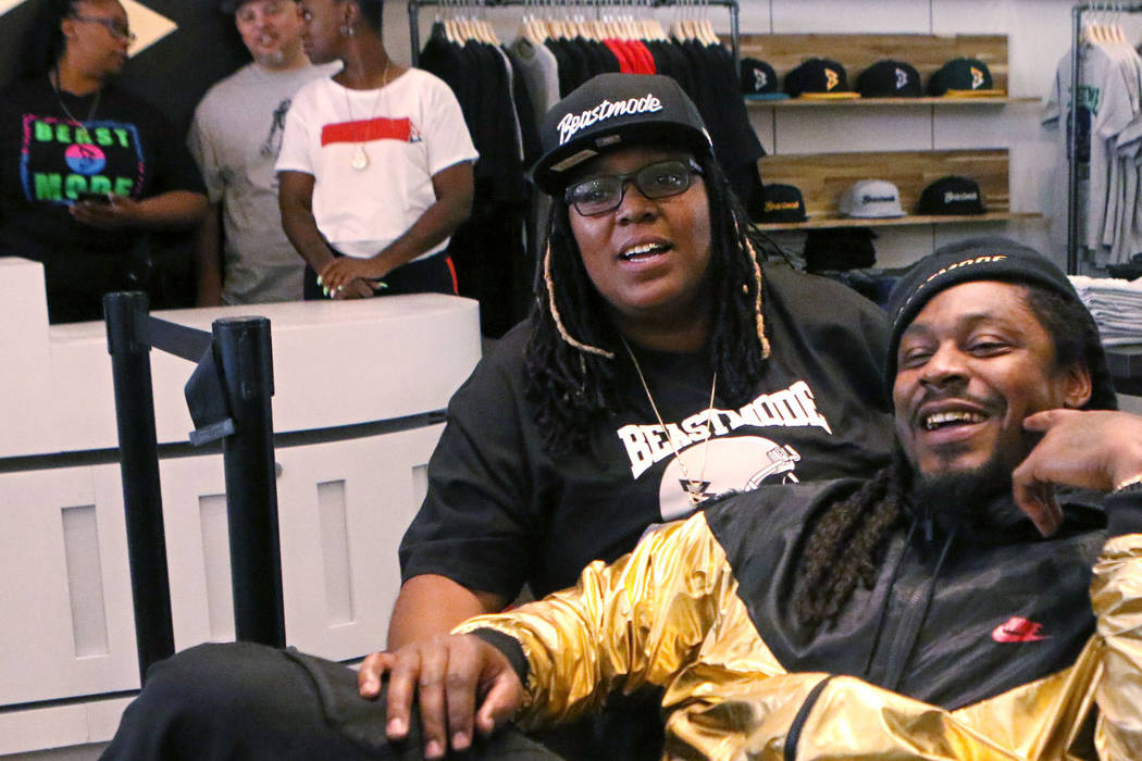 "Oakland Raiders running back Marshawn Lynch, center, and his sister Marreesha ""Lemon"" Lynch, right, are interviewed at the grand opening of his store, Beastmode, at Town Square in Las Ve ..."