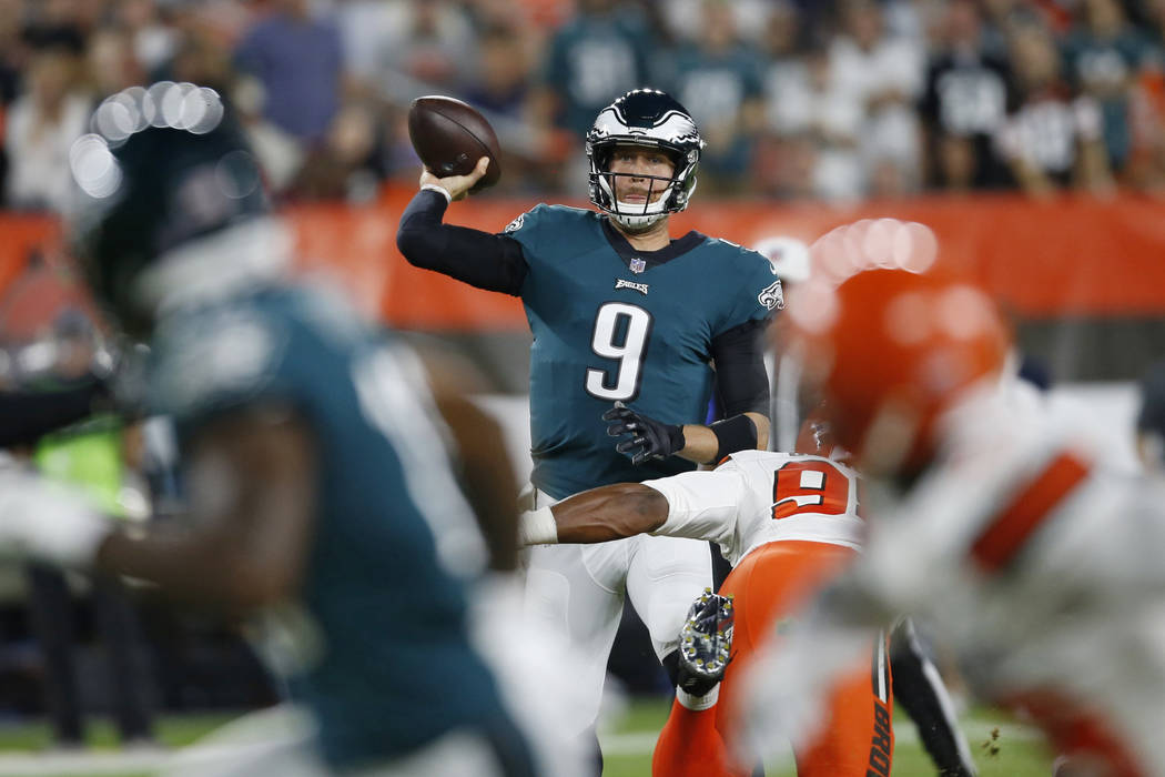 Philadelphia Eagles quarterback Nick Foles throws during the first half of the team's NFL preseason football game against the Cleveland Browns, Thursday, Aug. 23, 2018, in Cleveland. (AP Photo/Ron ...