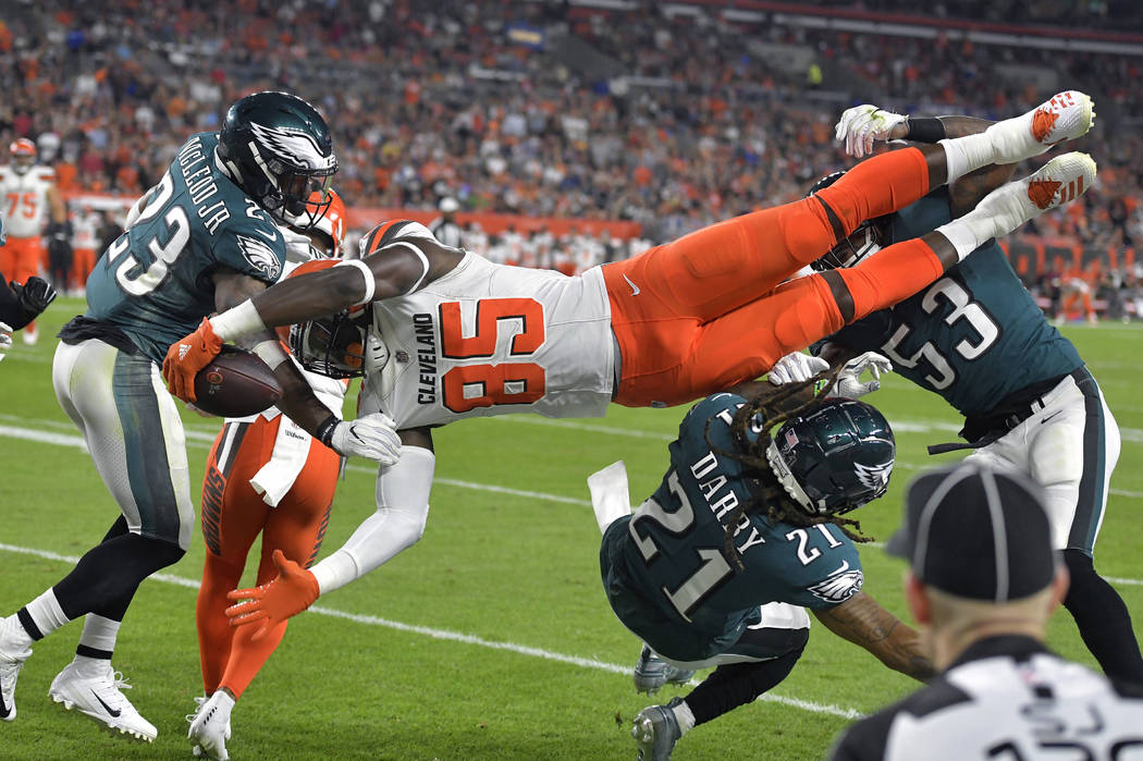 Cleveland Browns tight end David Njoku (85) is up-ended during the first half of an NFL preseason football game against the Philadelphia Eagles, Thursday, Aug. 23, 2018, in Cleveland. (AP Photo/Da ...