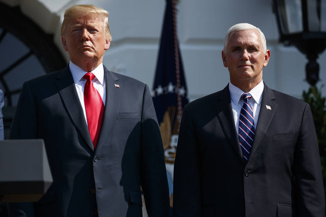 President Donald Trump stands with Vice President Mike Pence after delivering remarks about the economy on the South Lawn of the White House, Friday, July 27, 2018, in Washington. (AP Photo/Evan V ...