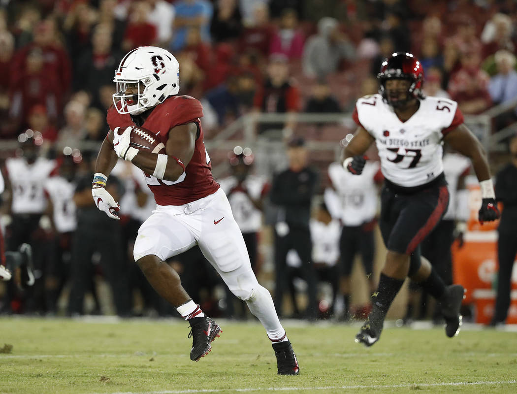 Stanford running back Bryce Love (20) runs for a first down against San Diego State during the second half of an NCAA college football game Friday, Aug. 31, 2018, in Stanford, Calif. Stanford won ...