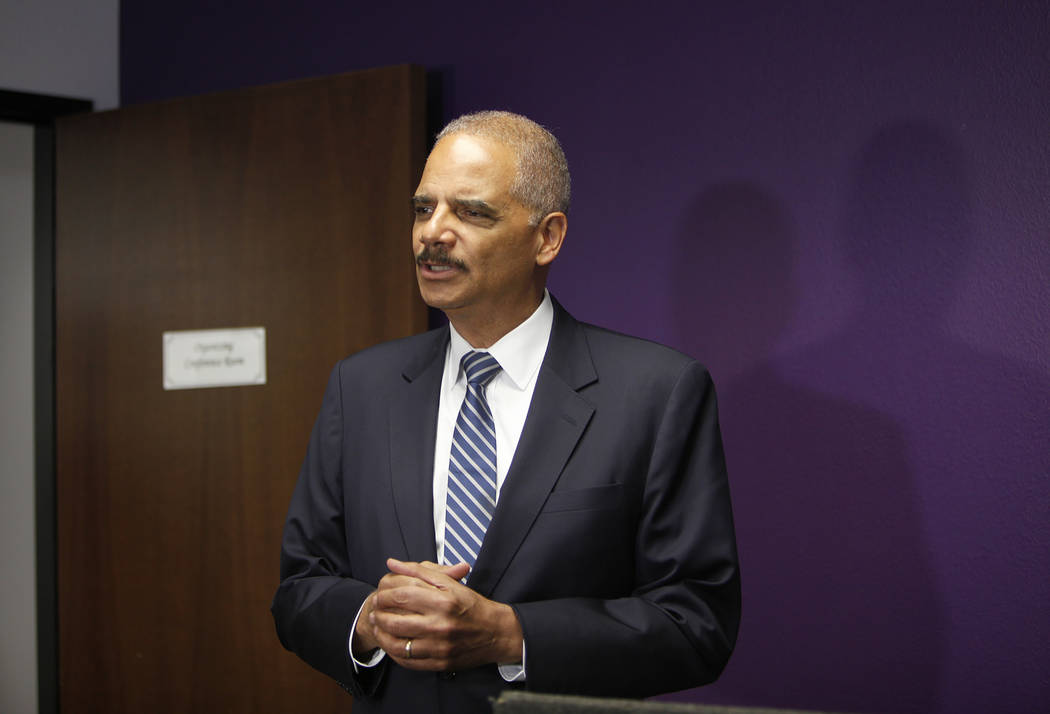 Former Attorney General Eric Holder answers reporters' questions before attending a criminal justice roundtable with Commissioner Steve Sisolak at the Service Employees International Union Local 1 ...