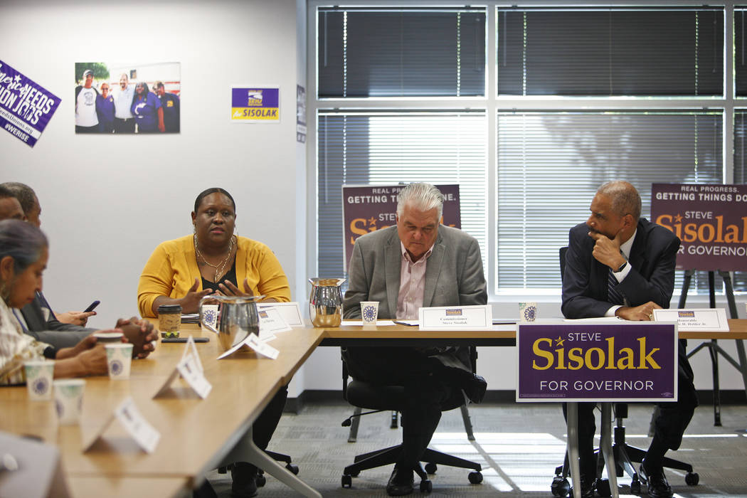 Leslie Turner, from left, an organizer with Mass Liberation that aims to reform the criminal justice system, tells her story to a roundtable that included Commissioner Steve Sisolak and Attorney G ...