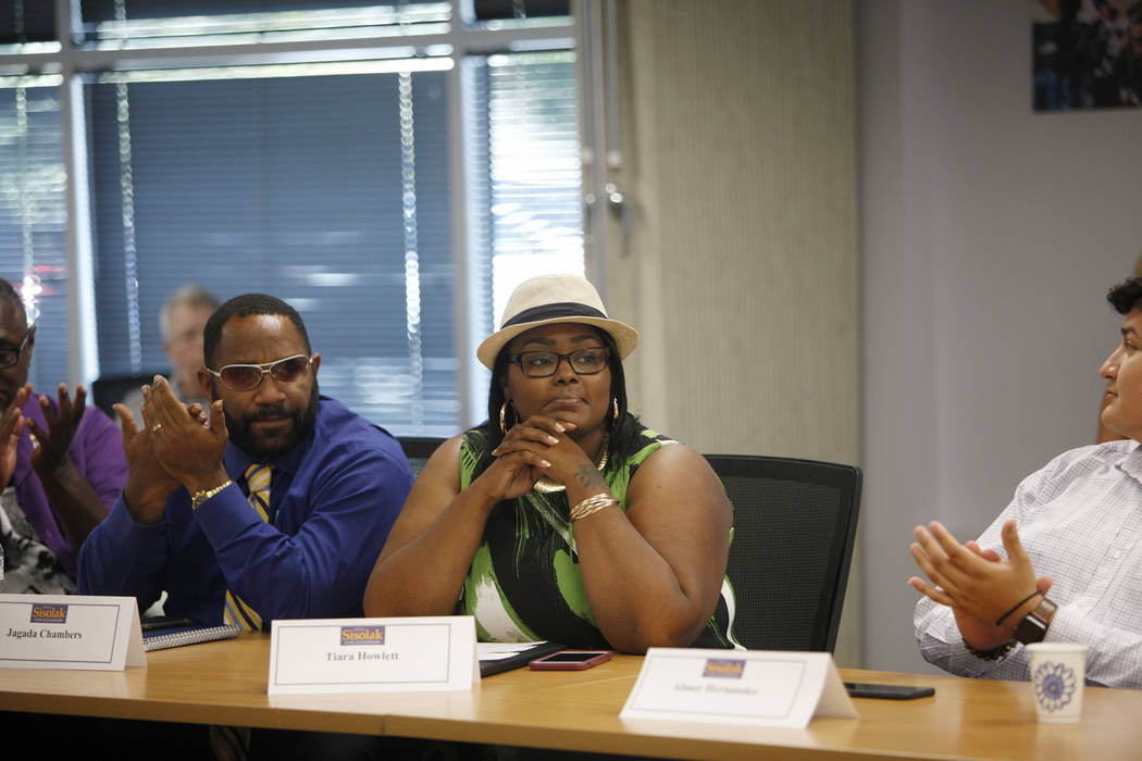 The room applauds Tiara Howlett after she told her story of how the criminal justice system disrupted her life and the Mass Liberation group was able to release her from jail at a roundtable that ...