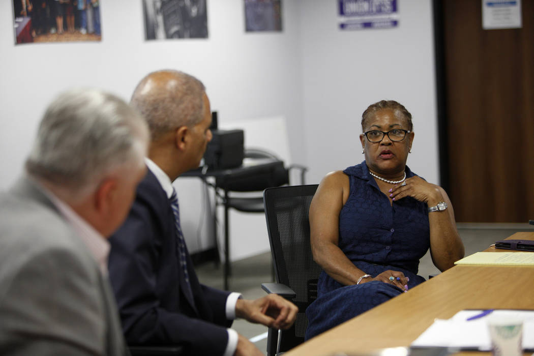 Mallory Jett-Edwards, from right, asks a question of former Attorney General Eric Holder and Commissioner Steve Sisolak at a roundtable about criminal justice reform at the Service Employees Inter ...