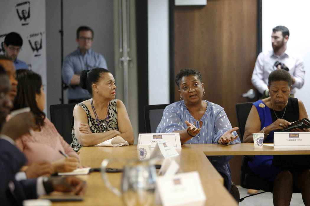 Clara Thomas asks a question of former Attorney General Eric Holder and Commissioner Steve Sisolak at a roundtable about criminal justice reform at the Service Employees International Union Local ...