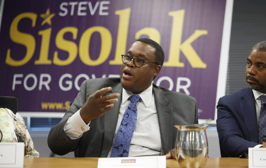 Councilman Cedric Crear speaks at a roundtable about criminal justice reform where former Attorney General Eric Holder and Commissioner Steve Sisolak listened and answered questions at the Service ...