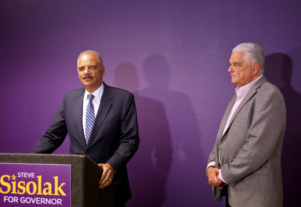 Former Attorney General Eric Holder, left, announces his endorsement of Commissioner Steve Sisolak for Nevada's governor at the Service Employees International Union Local 1107 offices in Las Vega ...