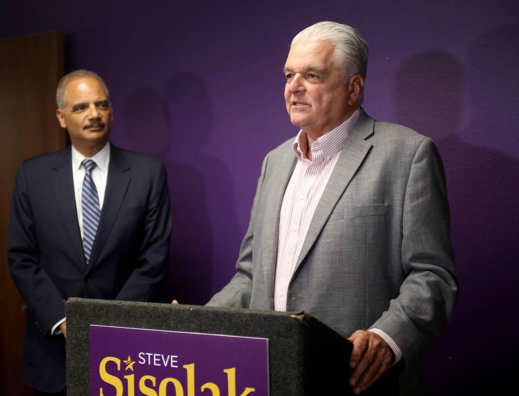 Commissioner Steve Sisolak addresses media after former Attorney General Eric Holder, left, formally endorsed him for governor at the Service Employees International Union Local 1107 offices in La ...