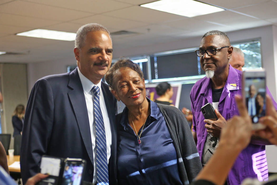 Former Attorney General Eric Holder, left, takes a photo with Ida Gaines after a roundtable about criminal justice reform at the Service Employees International Union Local 1107 offices in Las Veg ...