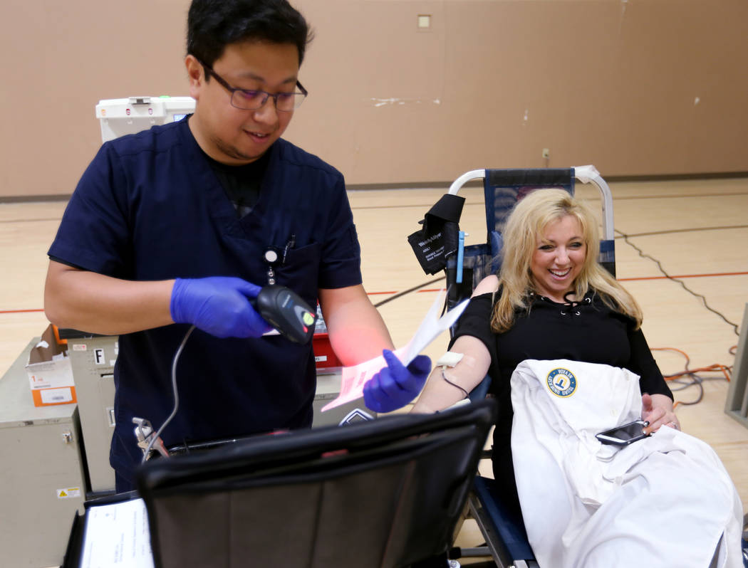 Syndicated radio personality and professor Dr. Daliah Wachs donates blood with United Blood Services Donor Care Specialist Christian Reyes at Touro University in Henderson Thursday, Sept. 6, 2018, ...