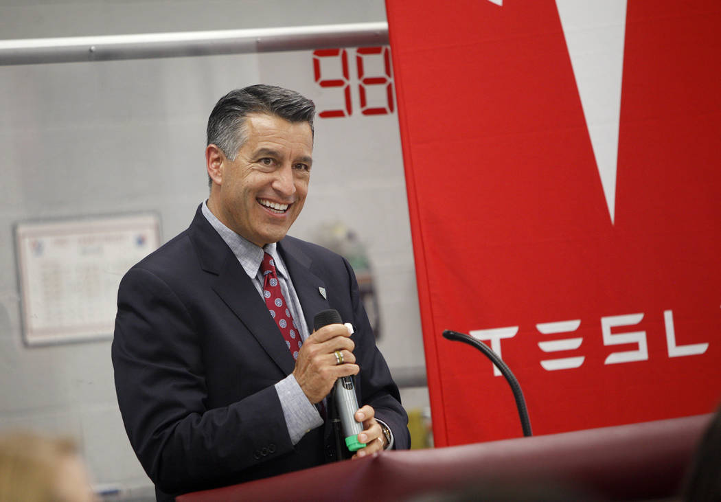 Gov. Brian Sandoval speaks at an event where Tesla and education leaders revealed new opportunities for robotics for education throughout the state at Cimarron-Memorial High School in Las Vegas, M ...